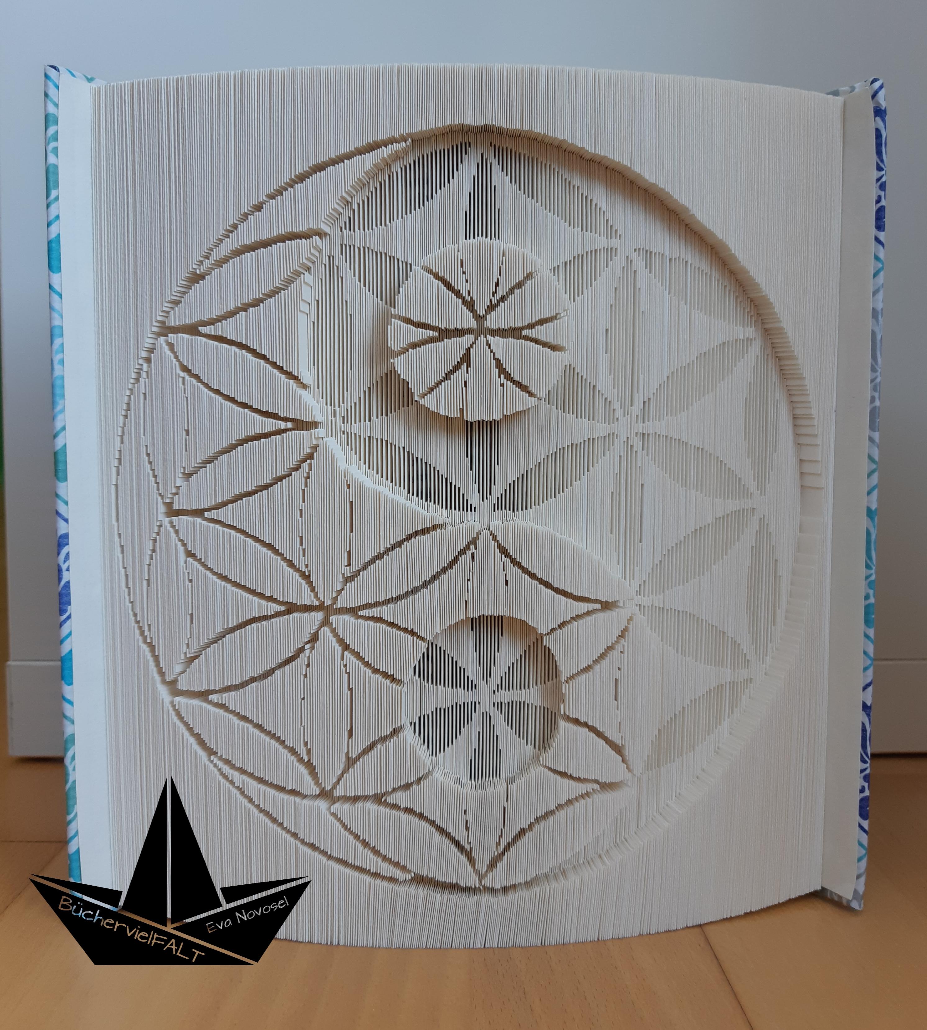 gefaltetes Buch Die Blume des Lebens und Yin Yang